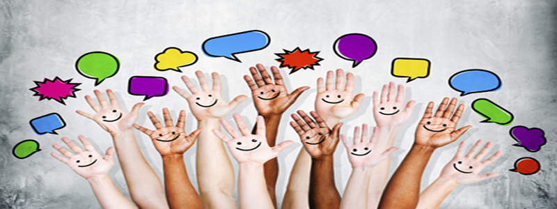 Multi Ethnic People's Hands Raised with Speech Bubble
