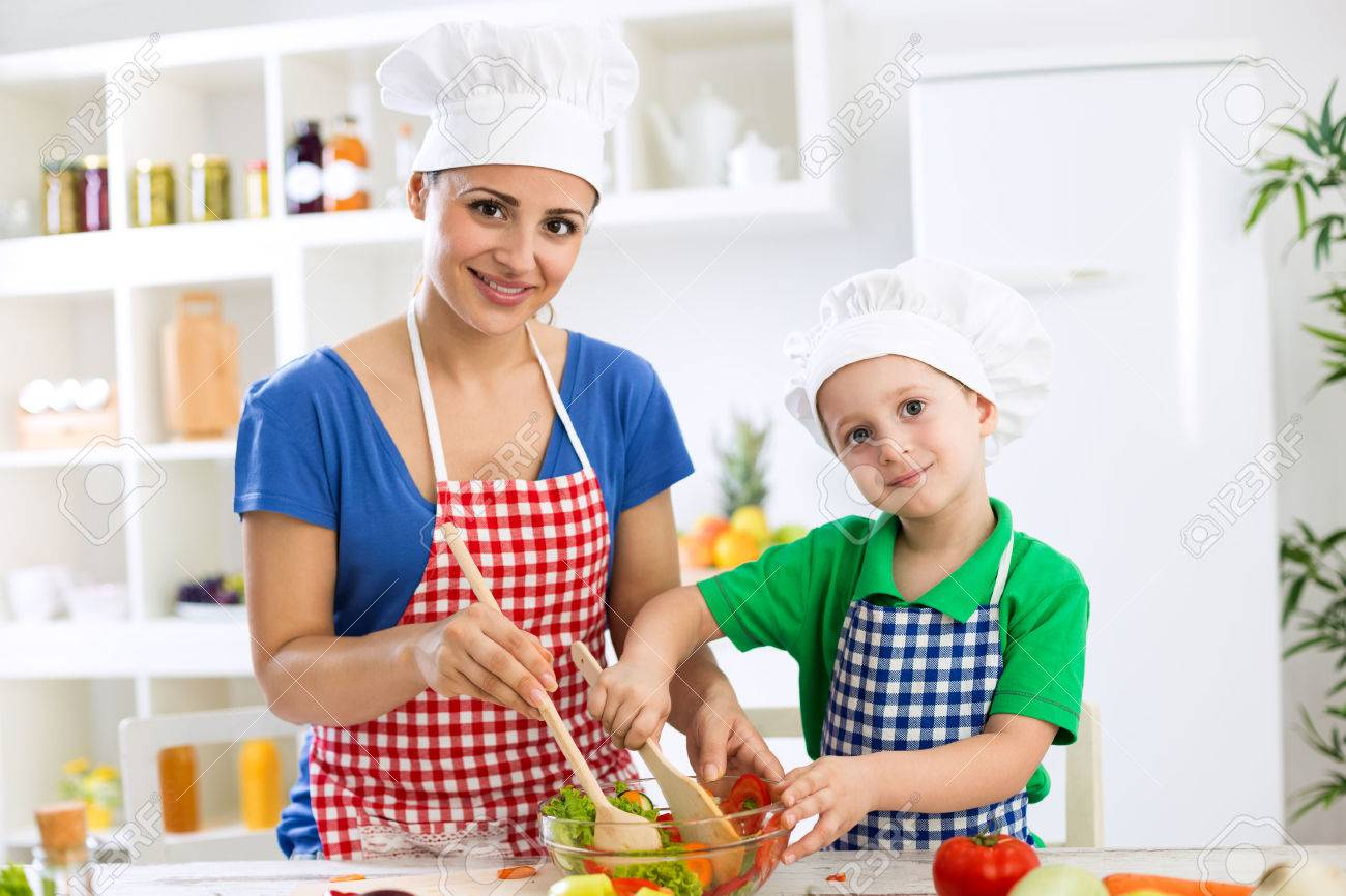 47719216-mother-and-child-cooking-together-with-scoops
